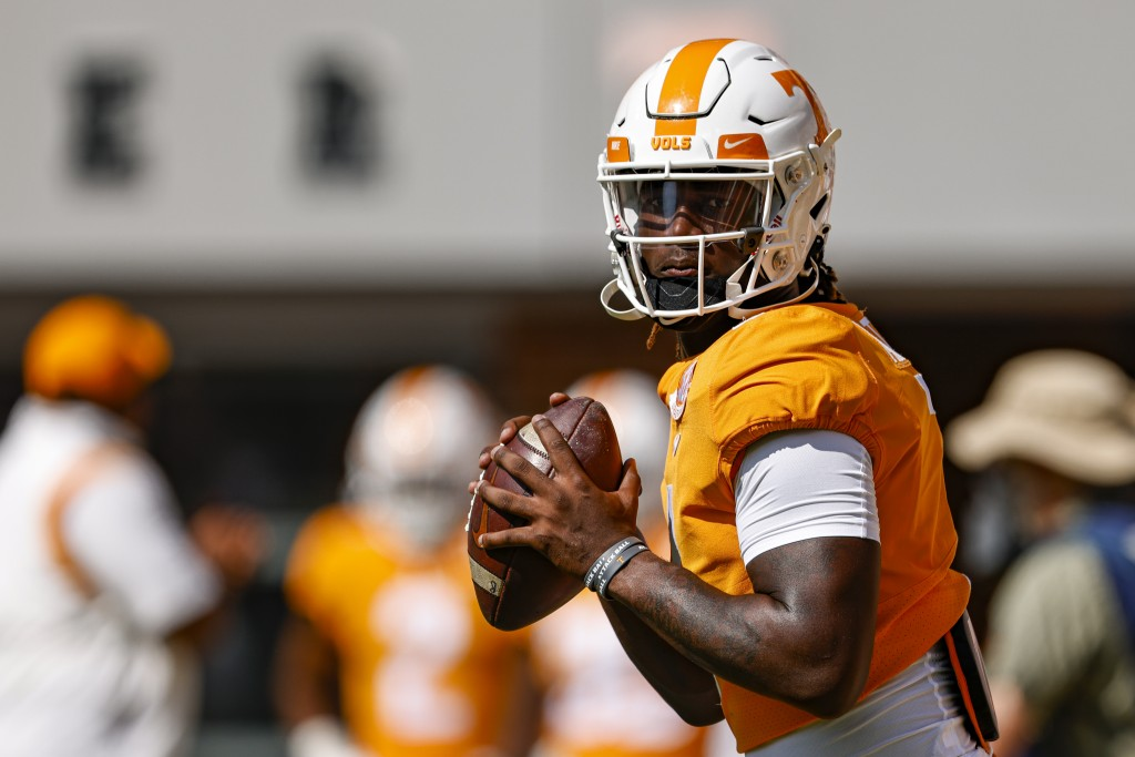 Tennessee quarterback Joe Milton III (7) looks for a receiver during warmups before an NCAA college football game against Pittsburgh Saturday, Sept. 1...