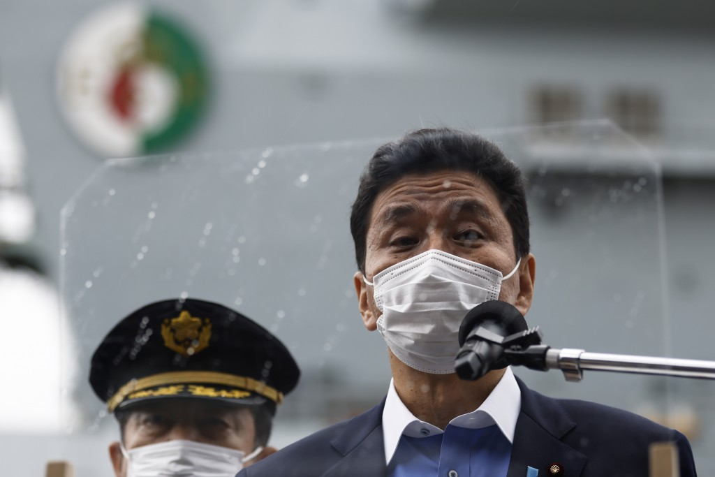 FILE - In this Sept. 6, 2021, file photo, Japan's Defense Minister Nobuo Kishi, speaks to the members of the media after he inspected the British Roya...