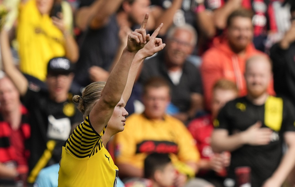 Dortmund's Erling Haaland celebrates after scoring his side's 4th goal with a penalty during the German Bundesliga soccer match between Bayer Leverkus...