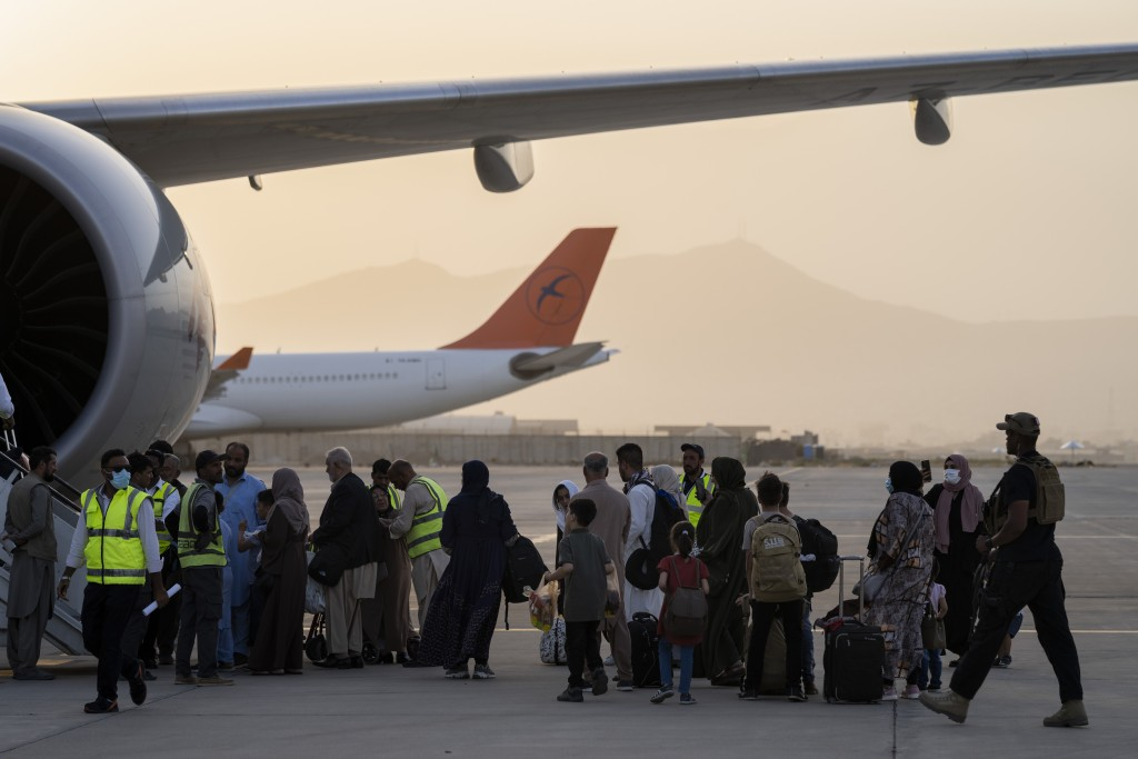 Foreigners board a Qatar Airways aircraft at the airport in Kabul, Afghanistan, Thursday, Sept. 9, 2021. Some 200 foreigners, including Americans, fle...