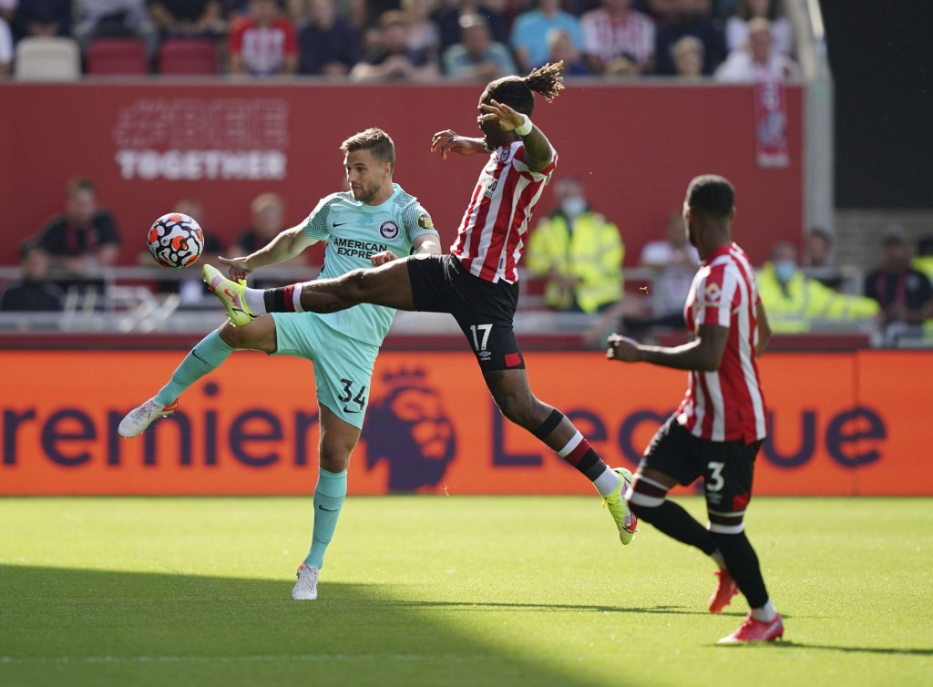Brighton and Hove Albion's Joel Veltman, left, and Brentford's Ivan Toney battle for the ball during their English Premier League soccer match at The ...