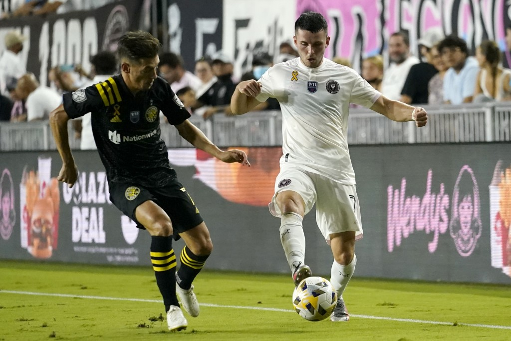 Inter Miami midfielder Lewis Morgan (7) controls the ball as Columbus Crew forward Pedro Santos, left, defends during the first half of an MLS soccer ...