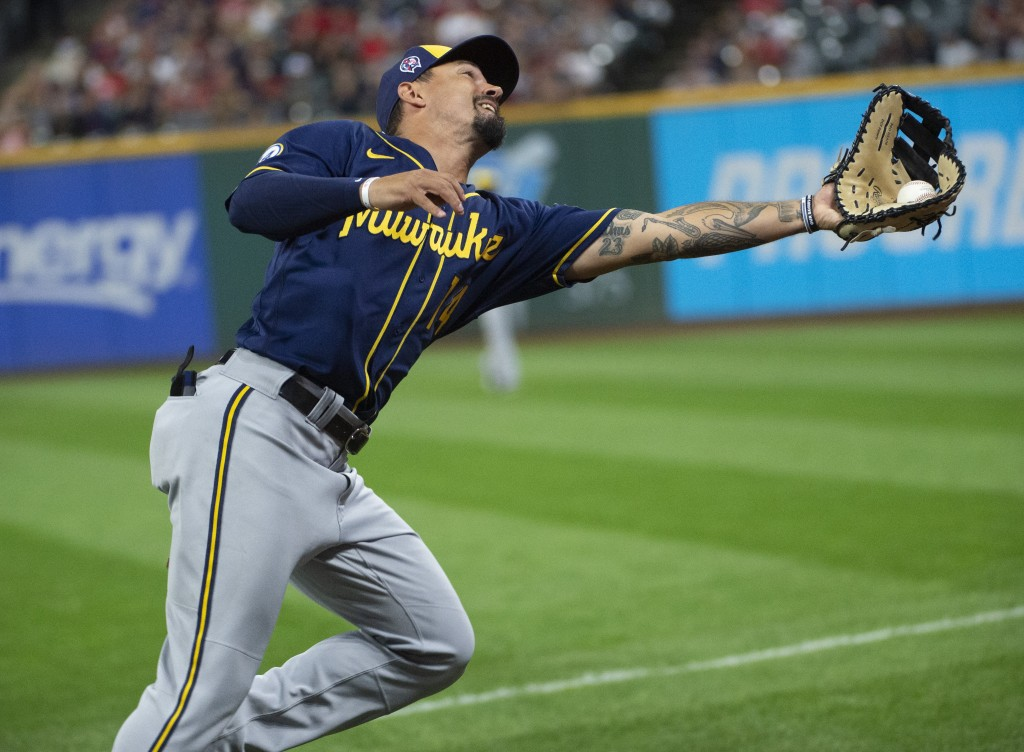 Milwaukee Brewers' Jace Peterson catches a pop foul by Cleveland Indians' Austin Hedges during the ninth inning of a baseball game in Cleveland, Satur...