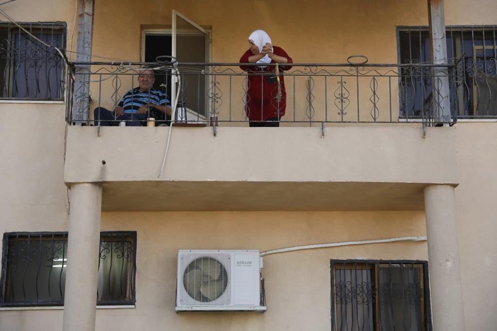 Locals look at Palestinian fugitive Zakaria Zubeidi's hideouts in Umm al-Ghanam, northern Israel, Saturday, Sept. 11, 2021. Following Zubeidi's arrest...