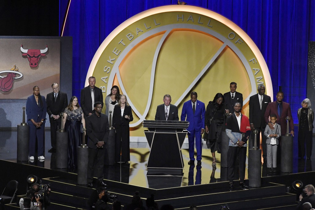 The class of 2021 Basketball Hall of Fame stands together on stage, Saturday, Sept. 11, 2021, in Springfield, Mass. (AP Photo/Jessica Hill)