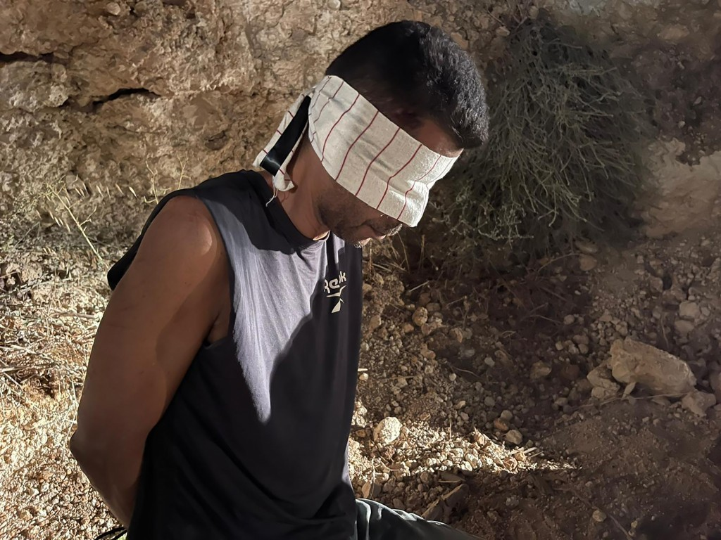 In this photo provided by Israel Police, Zakaria Zubeidi, one of the six Palestinians who escaped from a high-security prison earlier this week, is bl...