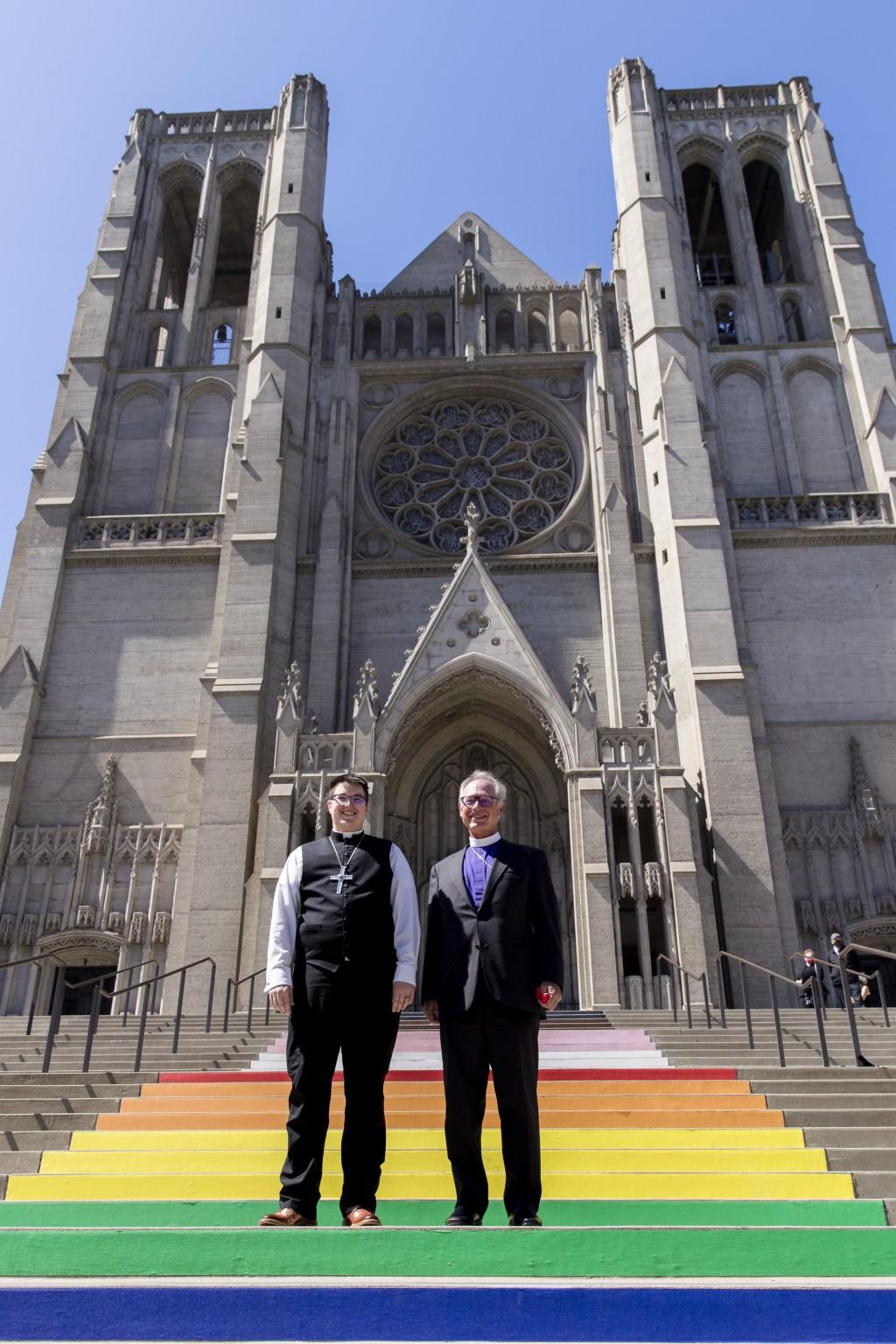 Bishop Megan Rohrer, left, and Bishop Marc Andrus stand on the rainbow steps before Bishop Rohrer's installation ceremony at Grace Cathedral in San Fr...