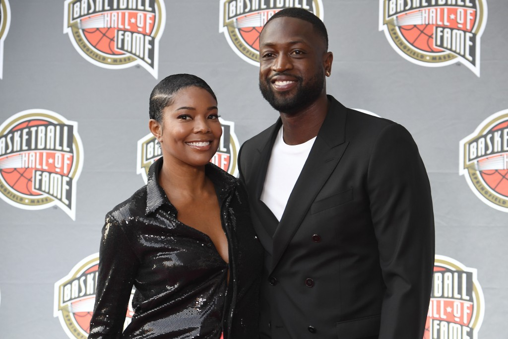 Gabrielle Union and Dwyane Wade pose for a photo on the red carpet for the 2021 Basketball Hall of Fame Enshrinement ceremony, Saturday, Sept. 11, 202...