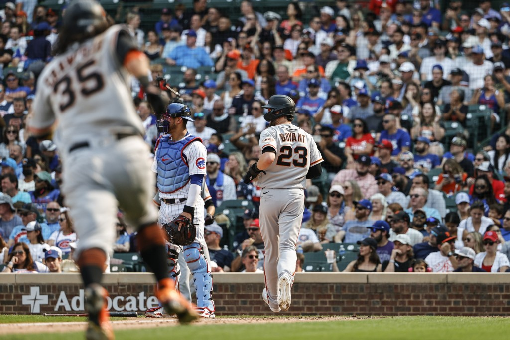 San Francisco Giants' Kris Bryant (23) scores on a two-run single hit by Mike Yastrzemski against the Chicago Cubs during the fifth inning of a baseba...