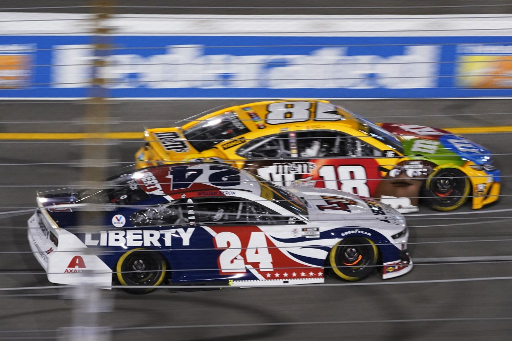 William Byron (24) and Kyle Busch (18) race into turn one during the NASCAR Cup series auto race in Richmond, Va., Saturday, Sept. 11, 2021. (AP Photo...