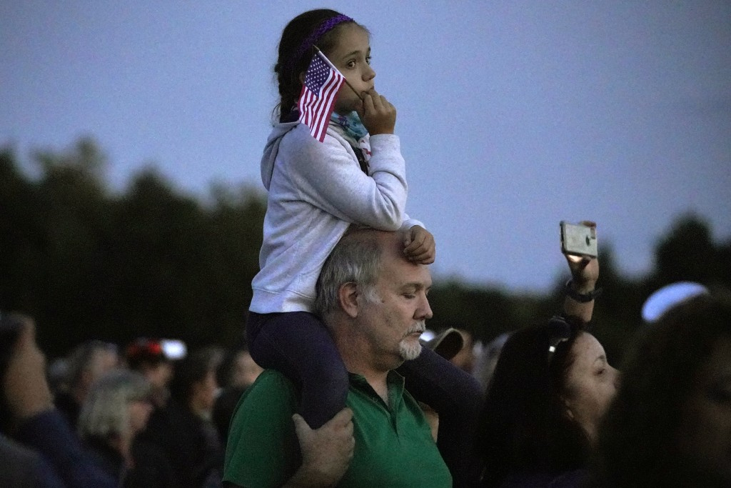 Allen Miller and daughter Erica, 9, from York, Pa., attend a candlelight memorial to the passengers and crew of United Flight 93, at the Flight 93 Nat...