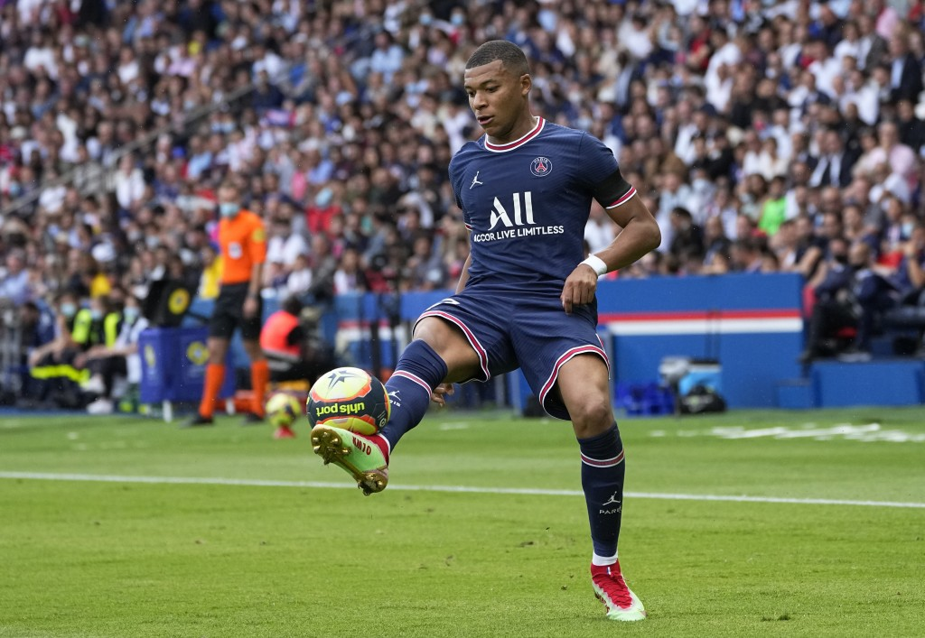 PSG's Kylian Mbappe in action during the French League One soccer match between Paris Saint-Germain and Clermont at the Parc des Princes stadium in Pa...