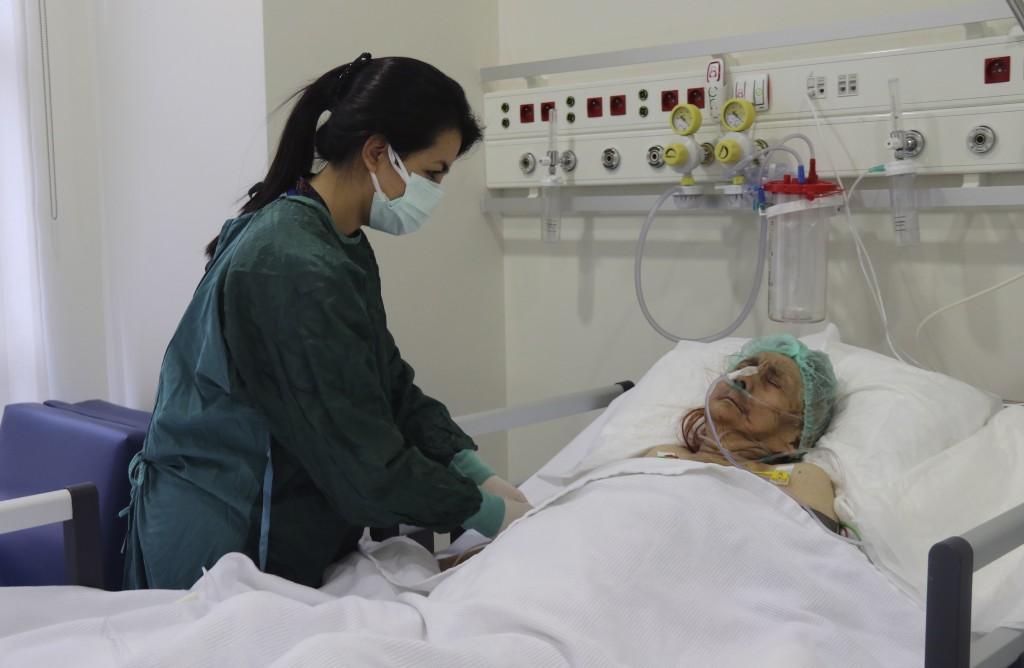 A nurse monitors Ayse Karatay at the City Hospital in Eskisehir, western Turkey, Saturday, Sept. 4, 2021. Karatay, a 116-year-old Turkish woman has su...