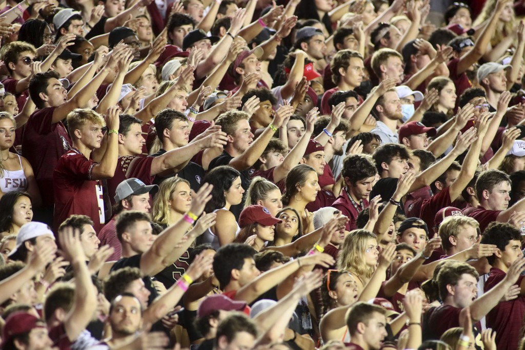 Florida State fans, almost none of whom were complying with the mandatory mask mandate, do The Chop during an NCAA college football game against Notre...