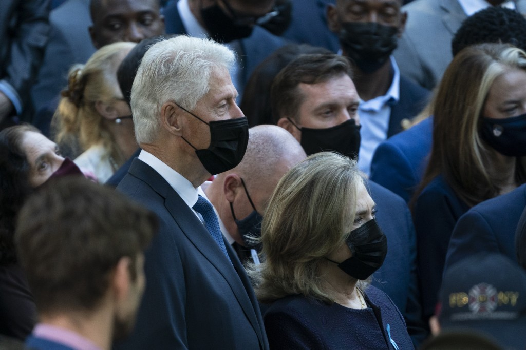Former President Bill Clinton, left, and former Secretary of State Hillary Clinton attend ceremonies to commemorate the 20th anniversary of the Sept. ...
