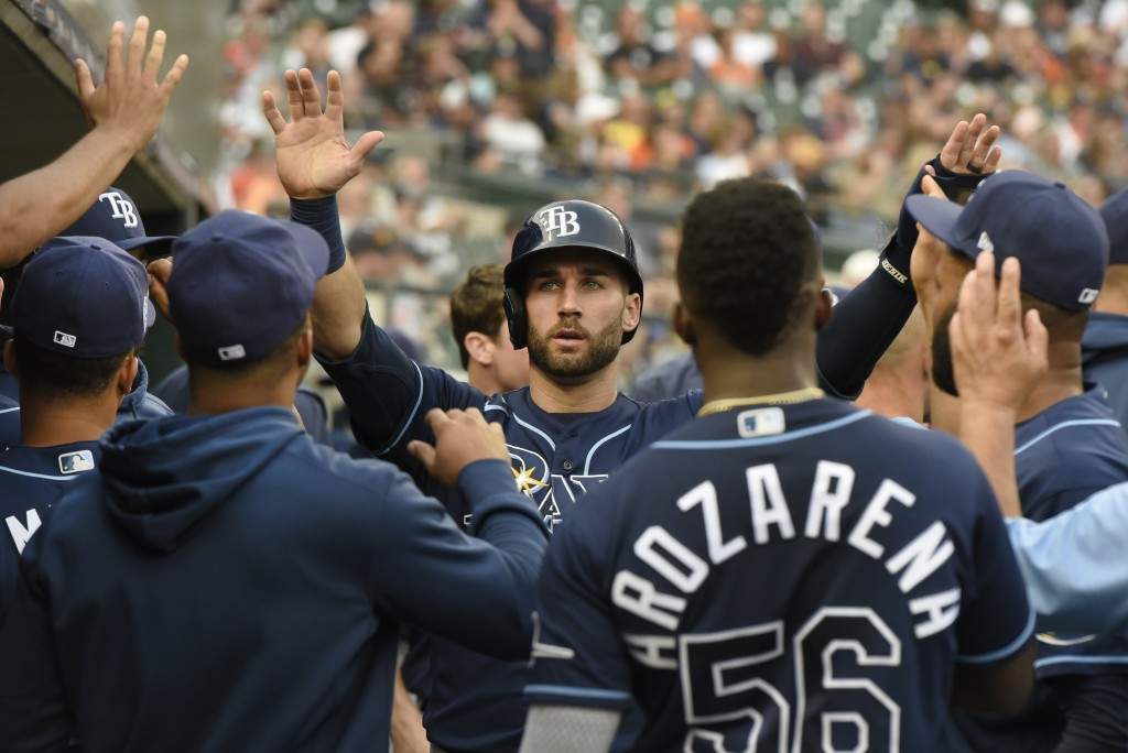 Tampa Bay Rays' Kevin Kiermaier, middle, is congratulated after scoring a run against the Detroit Tigers duirng the second inning of a baseball game S...