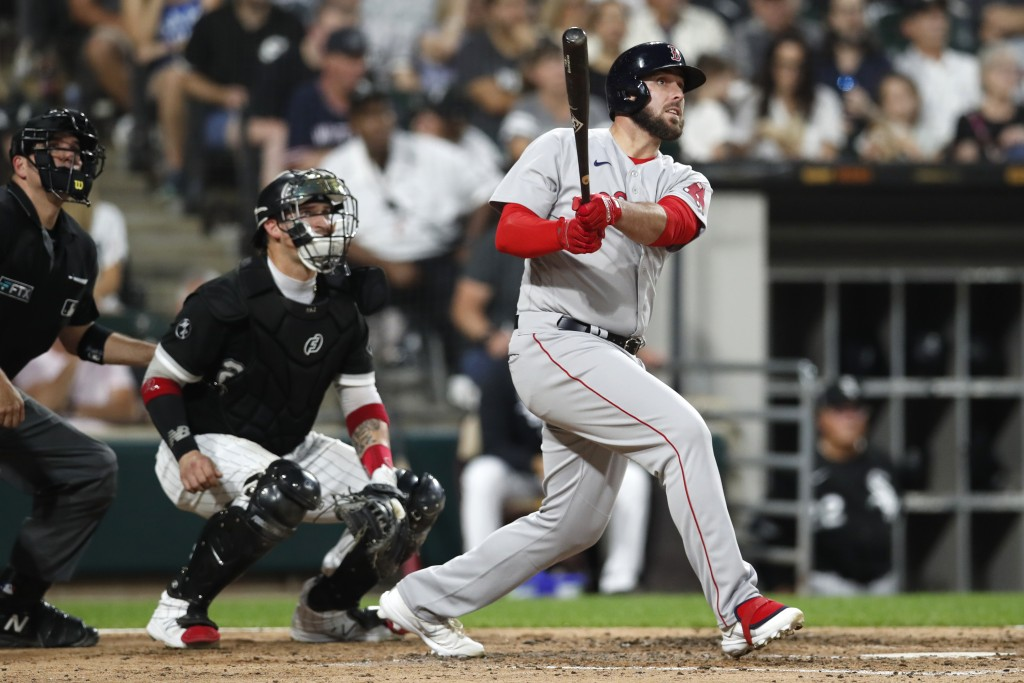 Boston Red Sox's Travis Shaw, right, watches his three-run home run in the third inning as Chicago White Sox catcher Yasmani Grandal, center, and umpi...