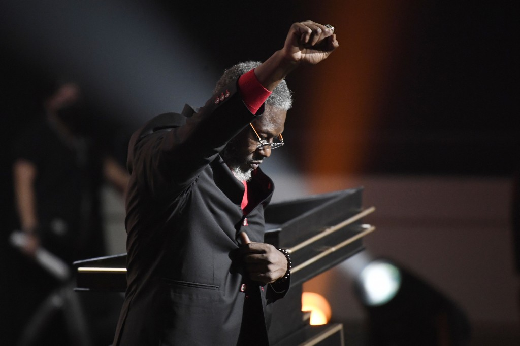 Inductee Ben Wallace pumps his fist into the air during the 2021 Basketball Hall of Fame Enshrinement ceremony, Saturday, Sept. 11, 2021, in Springfie...
