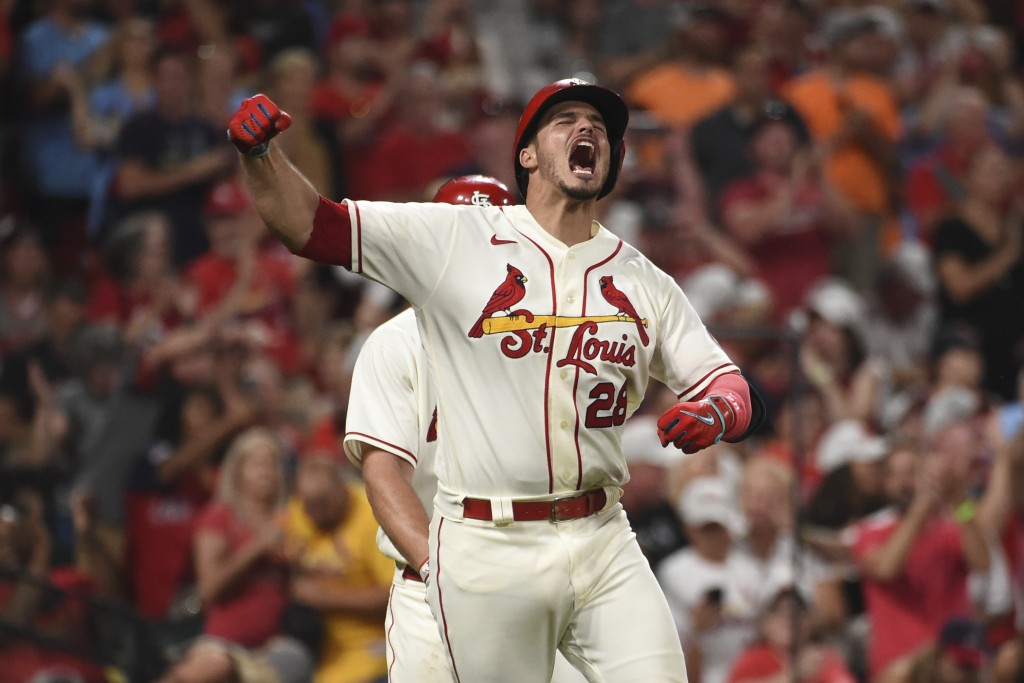 St. Louis Cardinals' Nolan Arenado reacts after hitting a two-run home run during the eighth inning of a baseball game against the Cincinnati Reds on ...