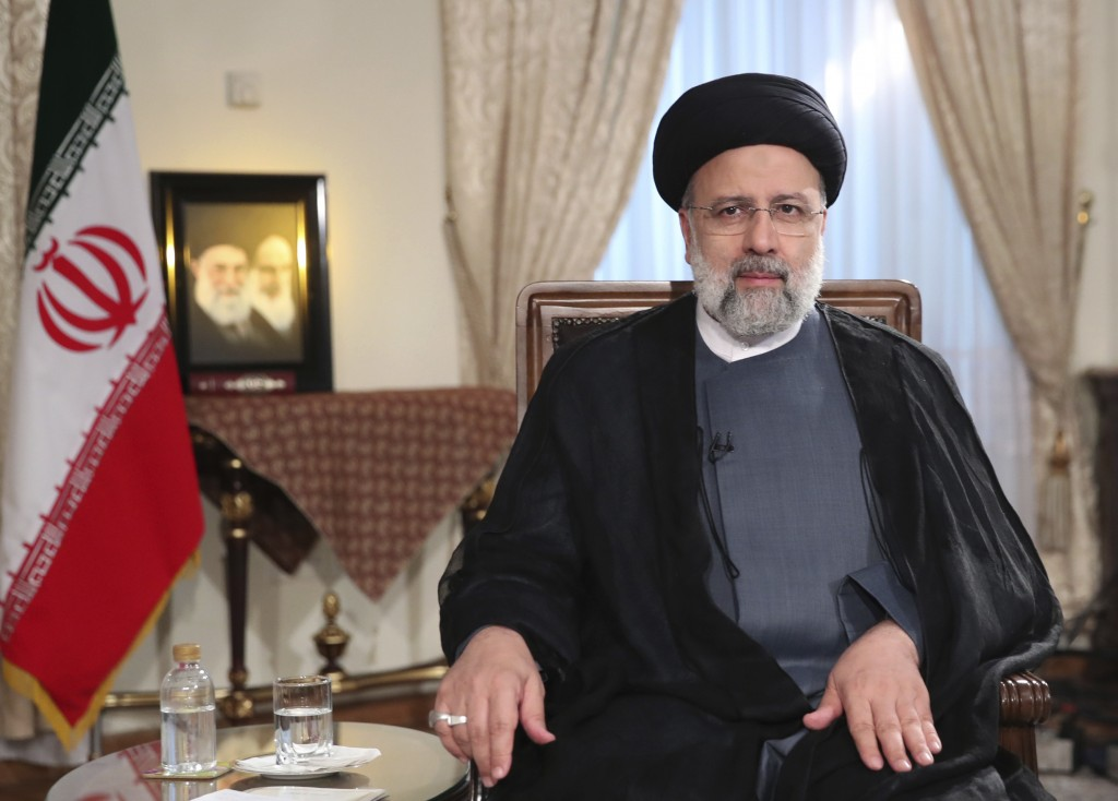 In this photo released by the official website of the office of the Iranian Presidency, President Ebrahim Raisi attends a live televised interview wit...