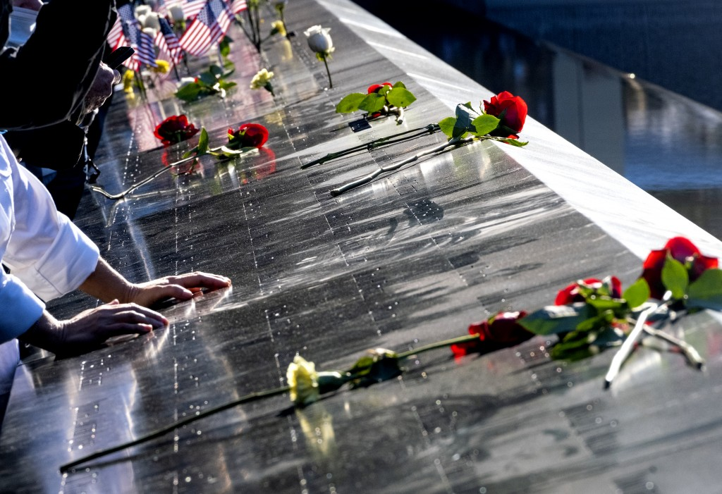 Flowers adorn the names of people who were killed during the attacks on the World Trade Center on Sept. 11, 2001, as families gather at the National S...