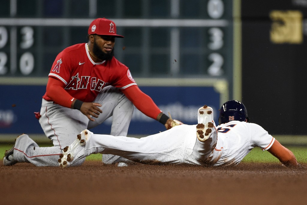 Houston Astros' Jose Siri, right, steals second past Los Angeles Angels shortstop Luis Rengifo during the fourth inning of a baseball game, Saturday, ...