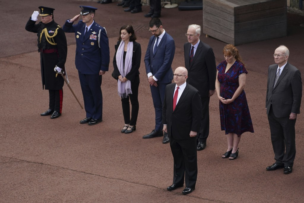 Delegates from the United States Embassy including Acting Ambassador, Philip T Reeker, foreground, stand at the Guard Change at Windsor Castle, during...