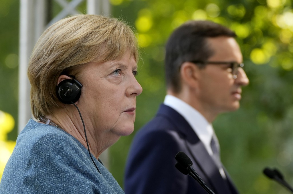 German Chancellor Angela Merkel, left, and Poland's Prime Minister Mateusz Morawiecki give a press conference in Warsaw, Poland, Saturday, Sept.11, 20...