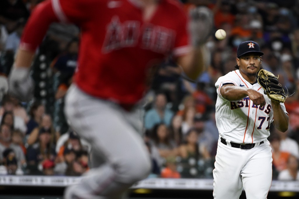 Houston Astros starting pitcher Luis Garcia, right, throws out Max Stassi during the third inning of a baseball game, Saturday, Sept. 11, 2021, in Hou...