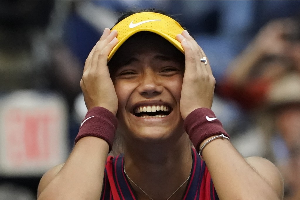Emma Raducanu, of Britain, reacts after defeating Leylah Fernandez, of Canada, during the women's singles final of the US Open tennis championships, S...