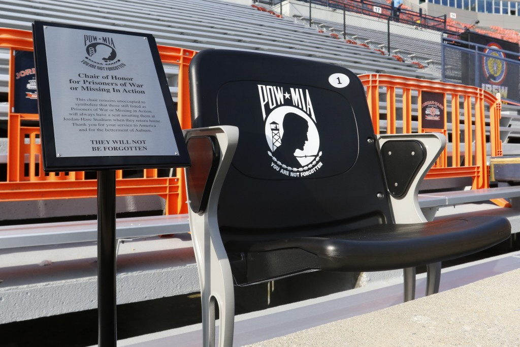 A seat to honor POW * MIA soldiers sits in the end zone before the kickoff of an NCAA football game between Auburn and Alabama State Saturday, Sept. 1...