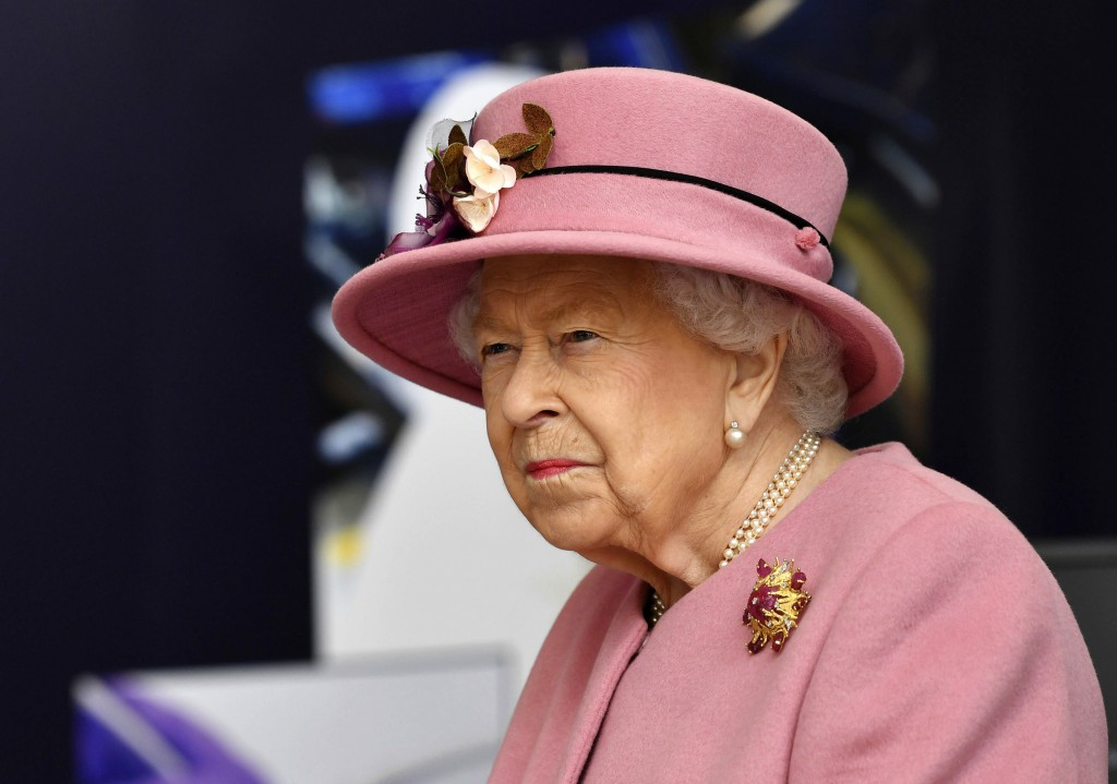 FILE - In this Thursday, Oct. 15, 2020 file photo, Britain's Queen Elizabeth II visits the Defence Science and Technology Laboratory (DSTL) at Porton ...