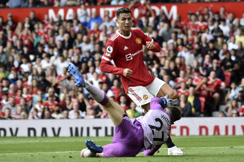 Newcastle's goalkeeper Freddie Woodman fails to stop Manchester United's Cristiano Ronaldo scoring the opening goal during the English Premier League ...