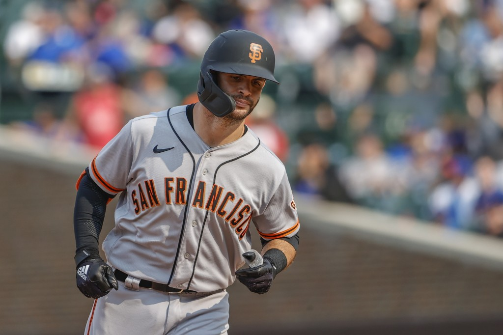 San Francisco Giants' Tommy La Stella rounds the bases after hitting a three-run home run off Chicago Cubs relief pitcher Tommy Nance during the fifth...