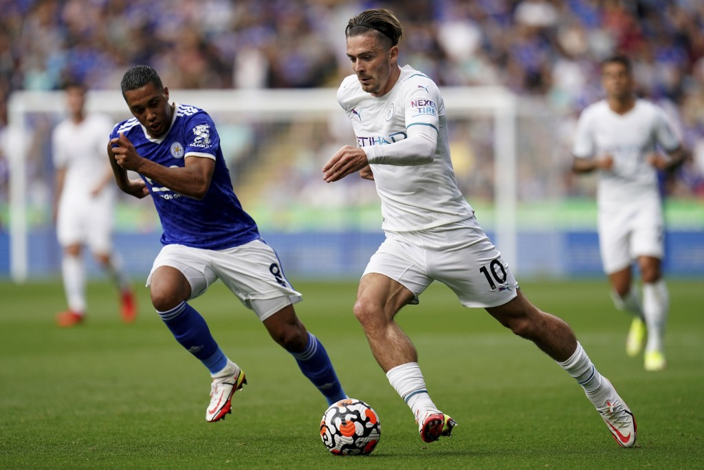 Manchester City's Jack Grealish, right, and Leicester City's Youri Tielemans in action during their English Premier League soccer match at The King Po...