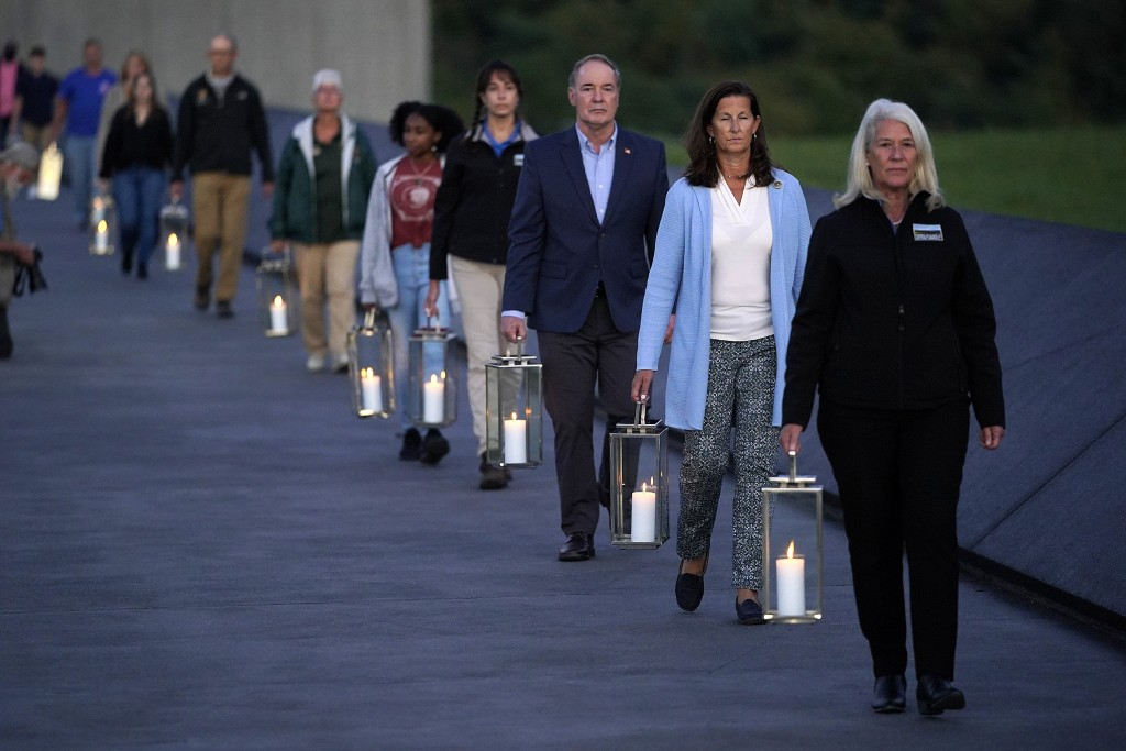 Lanterns are carried during a candlelight memorial to the passengers and crew of United Flight 93, at the Flight 93 National Memorial in Shanksville, ...