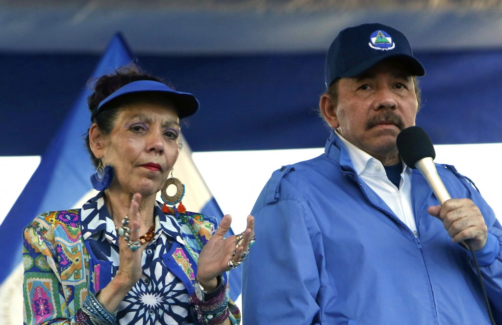 FILE - In this Sept. 5, 2018 file photo, Nicaragua's President Daniel Ortega and his wife, Vice President Rosario Murillo, lead a rally in Managua, Ni...