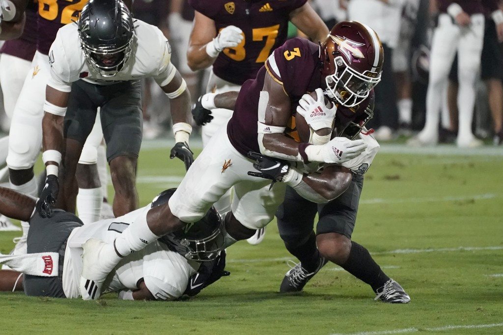 Arizona State running back Rachaad White (3) is hit by UNLV defensive back Bryce Jackson, right, during the first half of an NCAA college football gam...