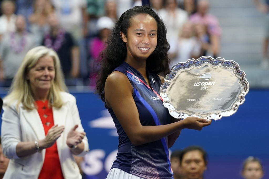 Leylah Fernandez, of Canada, holds up the runner-up trophy after losing to Emma Raducanu, of Britain, during the women's singles final of the US Open ...