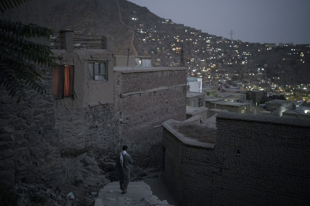 A man walks down the stairs at dusk in Kabul, Afghanistan, Saturday, Sept. 11, 2021. (AP Photo/Felipe Dana)