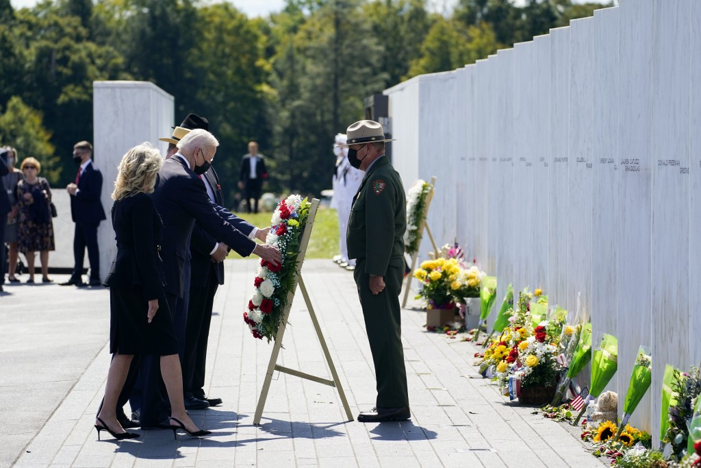 President Joe Biden and first lady Jill Biden lay a wreath at the Wall of Names during a visit to the Flight 93 National Memorial in Shanksville, Pa.,...