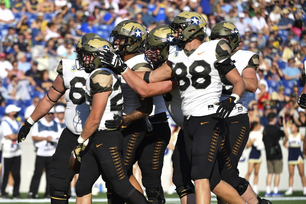 Air Force players celebrate running back Brad Roberts left, first half touchdown during an NCAA college football game Navy, Saturday, Sept. 11, 2021, ...