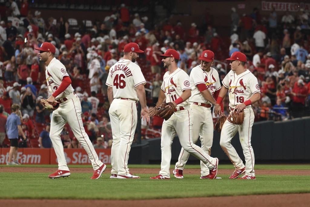 Members of the St. Louis Cardinals celebrate their victory over the St. Louis Cardinals in a baseball game Saturday, Sept. 11, 2021, in St. Louis. (AP...