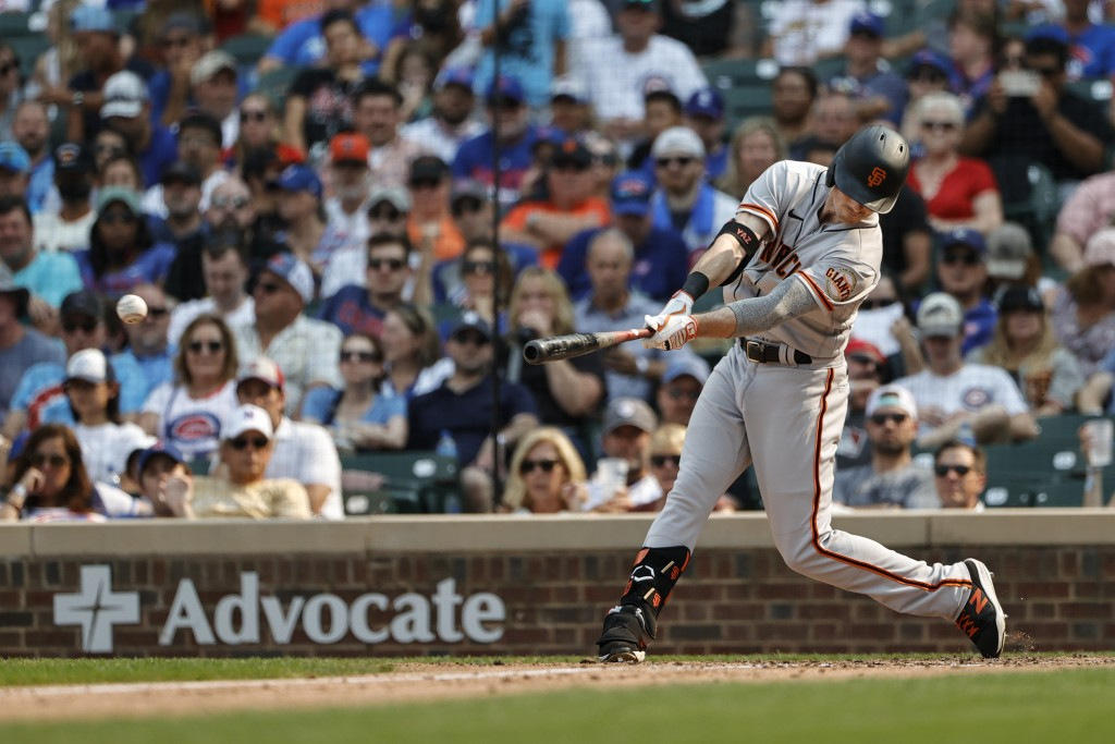 San Francisco Giants' Mike Yastrzemski hits a two-run single off Chicago Cubs relief pitcher Manuel Rodriguez during the fifth inning of a baseball ga...
