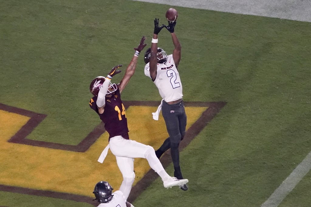 UNLV defensive back Nohl Williams (2) intercepts a pass in the end zone intended for Arizona State wide receiver Johnny Wilson (14) during the first h...