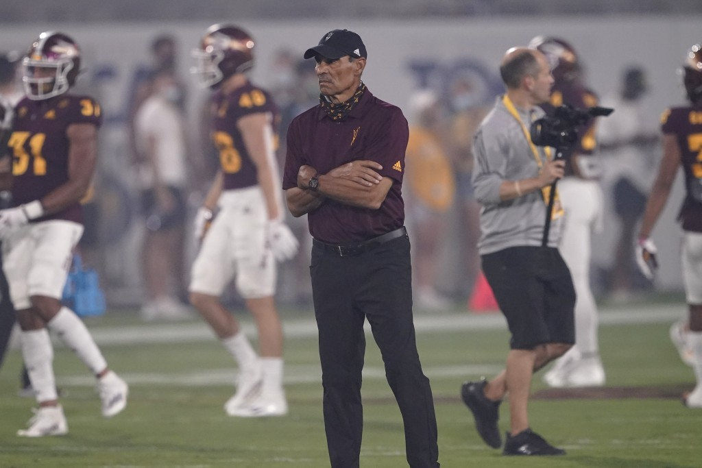 Arizona State head coach Herm Edwards watches warm ups prior to an NCAA college football game against UNLV, Saturday, Sept. 11, 2021, in Tempe, Ariz. ...
