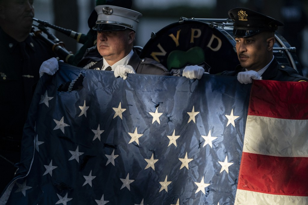 Flag bearers rehearse before ceremonies to commemorate the 20th anniversary of the Sept. 11 terrorist attacks, Saturday, Sept. 11, 2021, at the Nation...