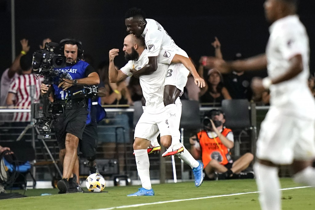 Inter Miami's Gonzalo Higuain, left, celebrates with midfielder Blaise Matuidi (8) after scoring a goal against the Columbus Crew during the first hal...