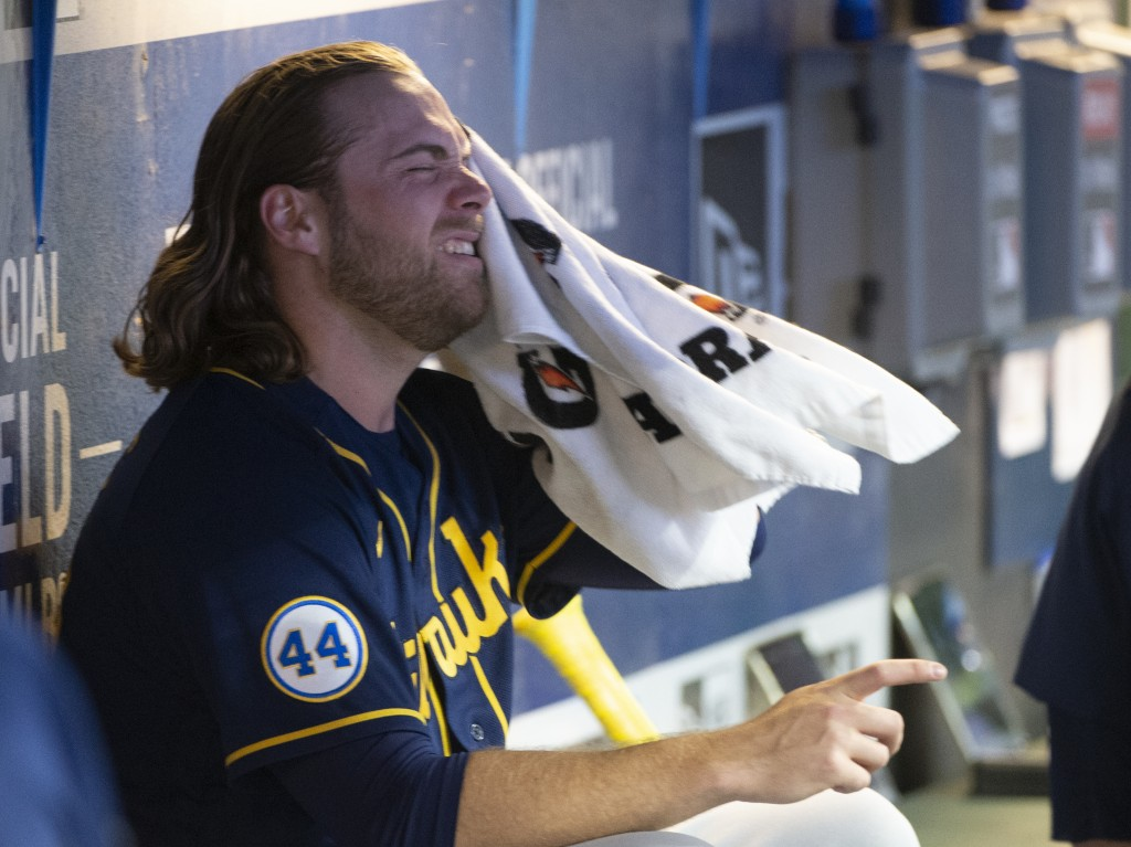 Milwaukee Brewers starting pitcher Corbin Burnes dries off between the sixth and seventh innings of a baseball game against the Cleveland Indians in C...