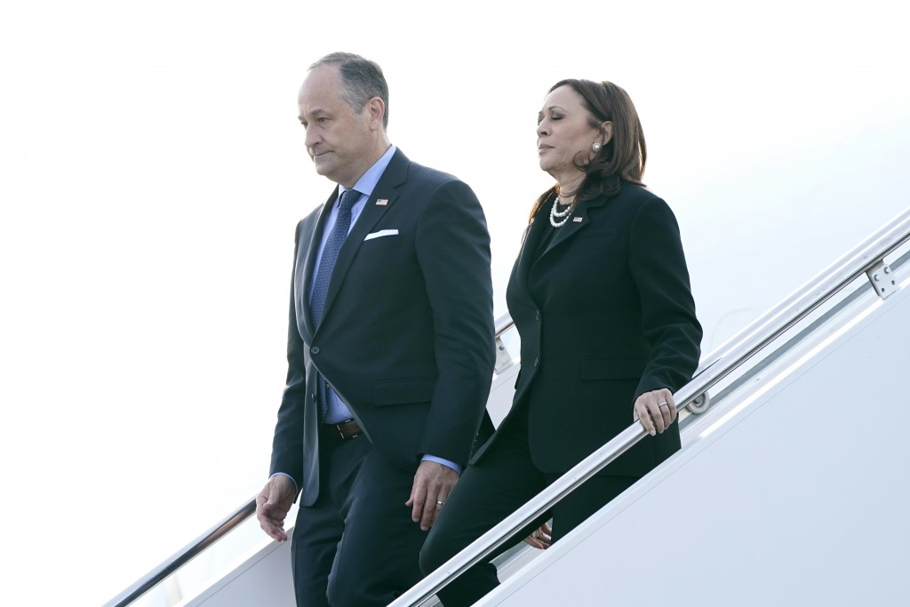 Vice President Kamala Harris and her husband Douglas Emhoff walk off of Air Force Two on arrival to Johnstown, Pa., on Saturday, Sept. 11, 2021, en ro...